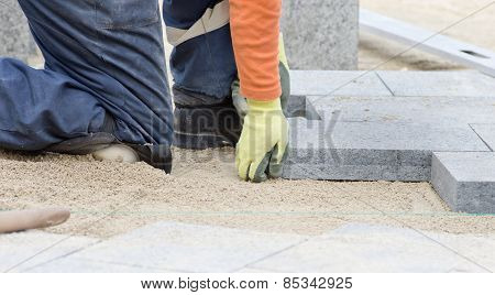 Paver Working On Knees