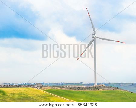 Wind Energy Turbines Are One Of The Cleanest, Renewable Electric Energy Source, Under Blue Sky With