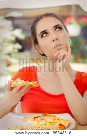 Young Woman Thinking About Eating Pizza on a Diet