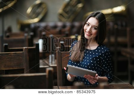 Beautiful Girl Working On A Tablet And Smiling