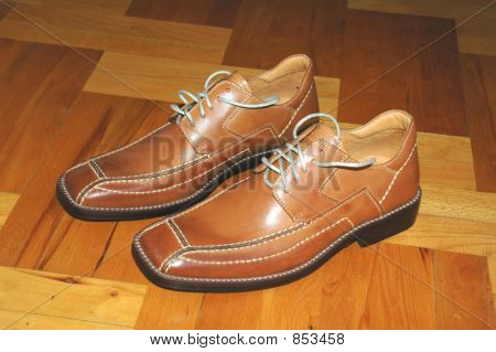 Male shoes on wooden floor