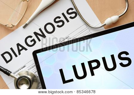 Tablet with diagnosis lupus and stethoscope.