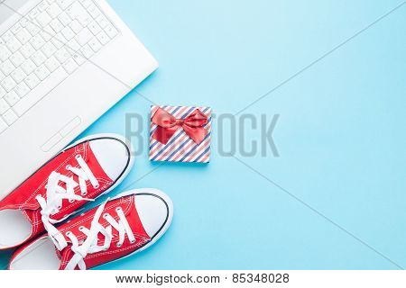 White Computer And Gumshoes With Gift