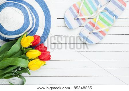 Bouquet Of Tulips And Flip Flops With Blue Hat