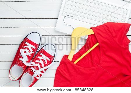 White Computer And Gumshoes And Dress