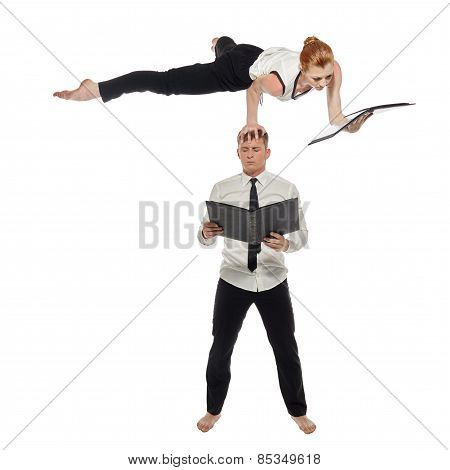 Multitasking. Businessmen-acrobats work in pair