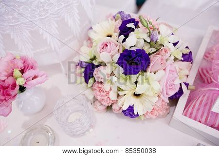 A Very Nicely Decorated Wedding Table With Plates And Serviettes