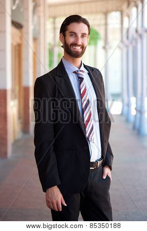 Friendly Young Businessman Smiling Outside