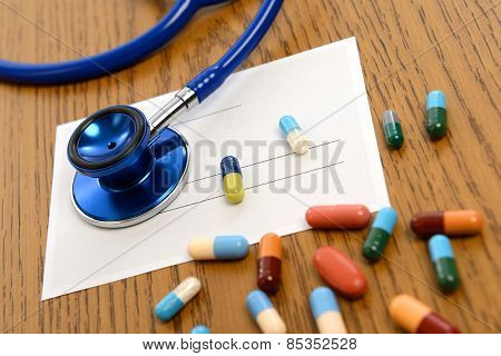 Prescription With Colorful Pills And Stethoscope