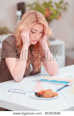 Beautiful young woman analyzing something