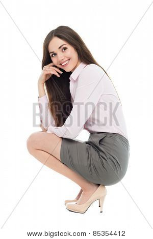 Beautiful woman crouching