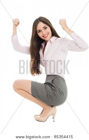 Beautiful woman crouching with arms raised