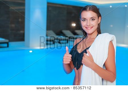 Beautiful woman in luxury swimming pool