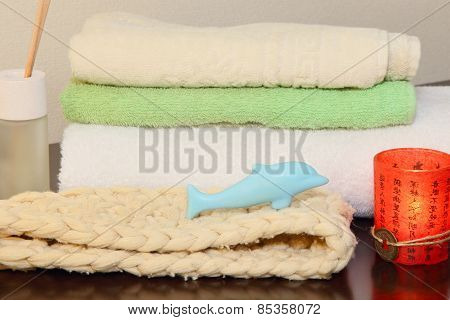 Towel Stack, Bast And Soap In The Form Of A Dolphin.