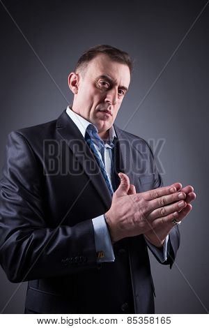 frightening man rubs his hands