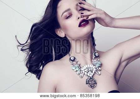Woman With Dark Hair And Bright Makeup With Luxurious Bijou