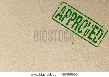 Paper texture with - Green Approved rubber stamp