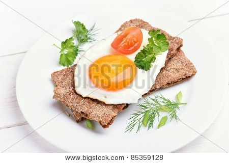 Crispbread With Egg, Tomato Slice And Herbs