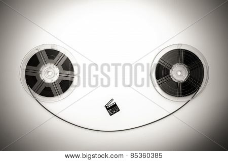 Vintage 8Mm Movie Reels And Little Clapper Sepia Black And White