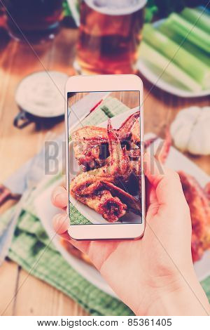 Using Smartphones To Take Photos Of Bbq Wings Set