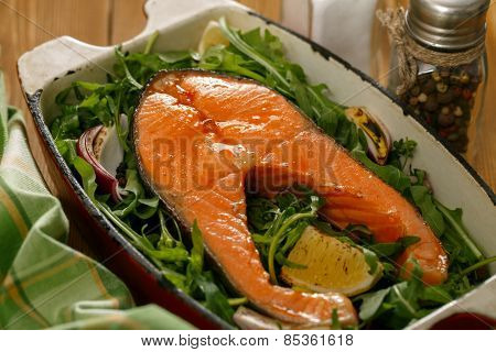 Salmon Steak With Fresh Vegetables In A Pan On A Wooden Table
