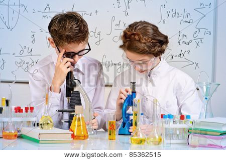 Students doing experiments in the laboratory. Science and education.