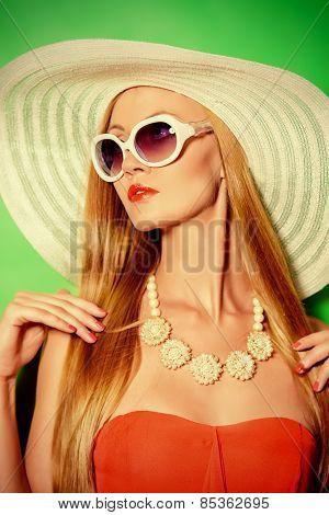 Portrait of a gorgeous fashionable lady. Vivid colors. Beauty, fashion concept. Optics. Jewelry.