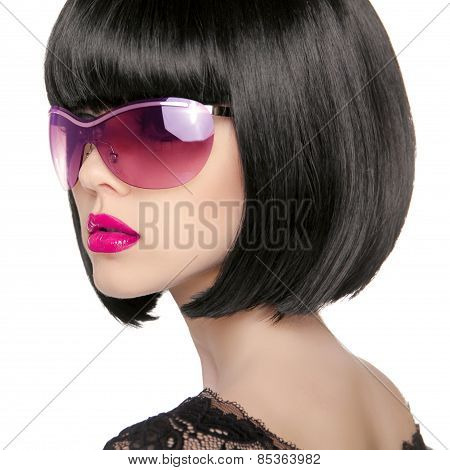 Brunette Model In Fashion Sunglasses. Beautiful Glamour Woman With Short Black Hairstyle Isolated On