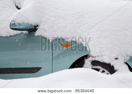 Car Covered With Big Snow