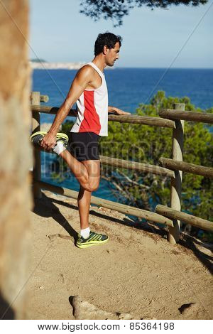 Full length shot of an attractive mature man stretching his hamstrings before the jog