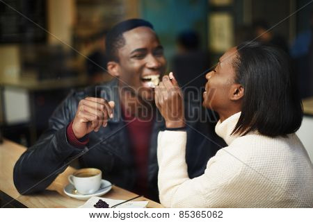 Beautiful dark skinned couple in love having a great time together