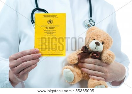 Pediatrician holding an international certificate of the vaccination
