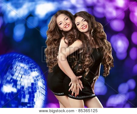 Cheerful Smiling Girls Dancing On The Dance Floor Over Blue Disco Background With Mirror Ball And Li