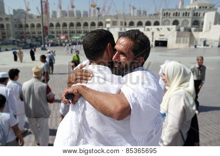Wrapped Together Two Muslim Pilgrims