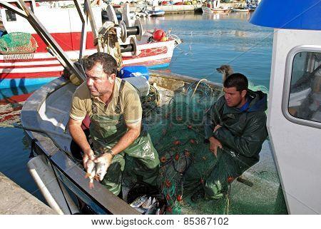 Fisherman in a boat, Puerto de la Atunara.