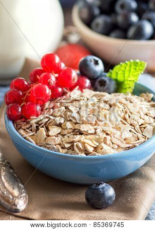 Rolled Oats In A Bowl With Berries And Milk