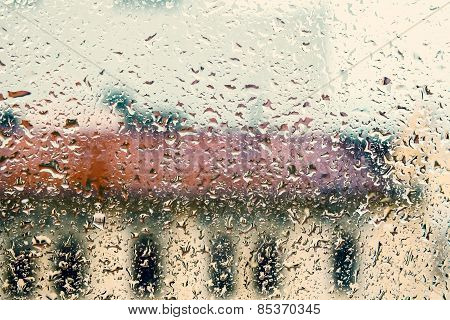 Rainy Background With Flowing Down Water Drops On Window