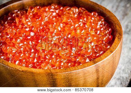 Fresh Red Caviar In A Wooden Bowl Closeup