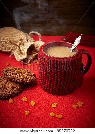 Mug of coffee with cookies