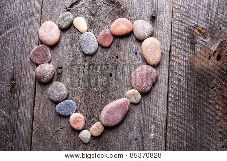 Stone Heart On Wooden Table