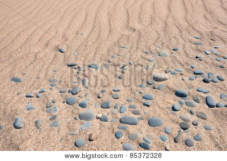 Sand and pebbles texture and background