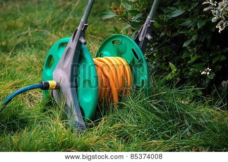 Water hose on grass outside