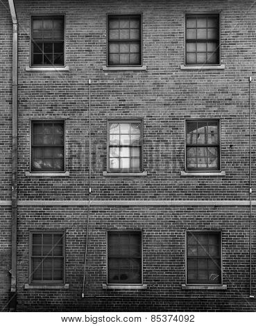 Black And White Photo Of Brick Facade With Windows