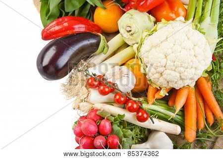 Assortment of various fresh organic vegetables from the garden isolated on white