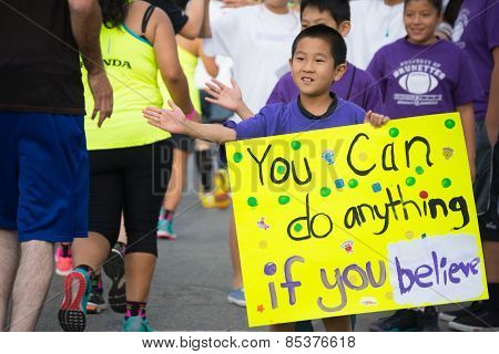 Unidentified Boy With Poster Participating In The 30Th La Marathon Edition