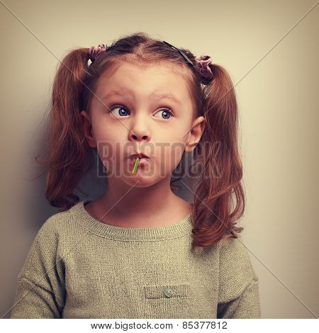 Fun Girl Eating Candy With Surprising Thinking Big Eyes. Vintage Portrait
