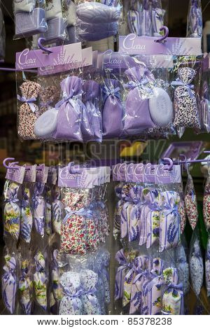 NICE, FRANCE - OCTOBER 2, 2014: Lavender sachets and soaps are sold as souvenirs on Rue Pairoliere, a quaint pedestrian shopping street in old Nice.