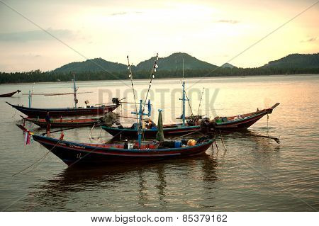 Traditional Fishing Long Tailed Boat In Koh Phitak Island, Thailand At Sunset.
