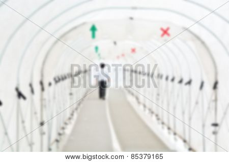 Blur Or Defocus Image Of Man Walking Under The Tunnel Of Canvas Rain Cover