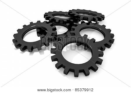 stack of black colored metallic cogwheels on white surface